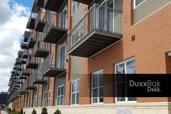 Image of a commercial apartment building with Duxxbak Dekk no drip through decks for each apartment.