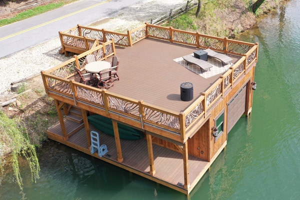 Image of a boat house and dock with upper level deck featuring DuxxBak's Commerical Dekk.