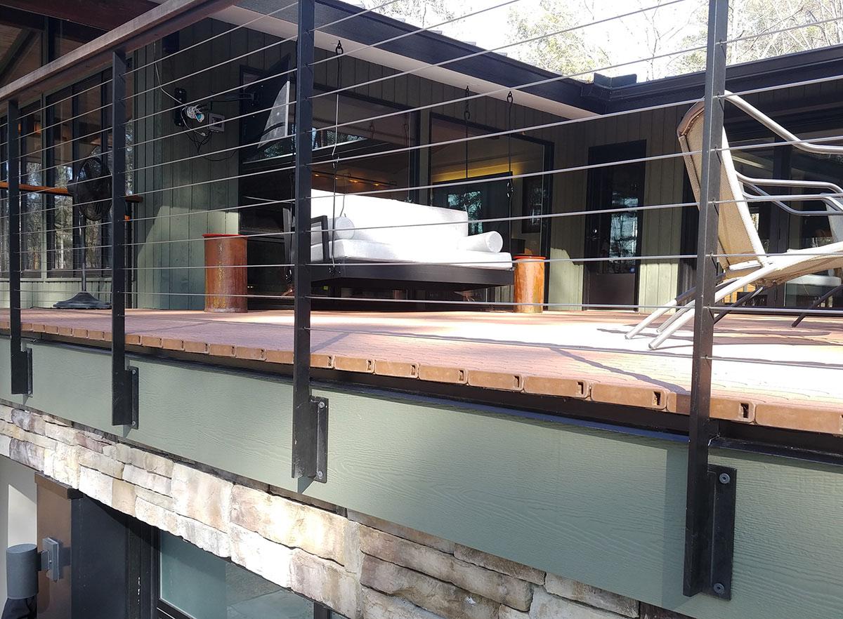 Image of outdoor deck featuring DuxxBak Dekk composite dekcing with superior composition to defy the elements.