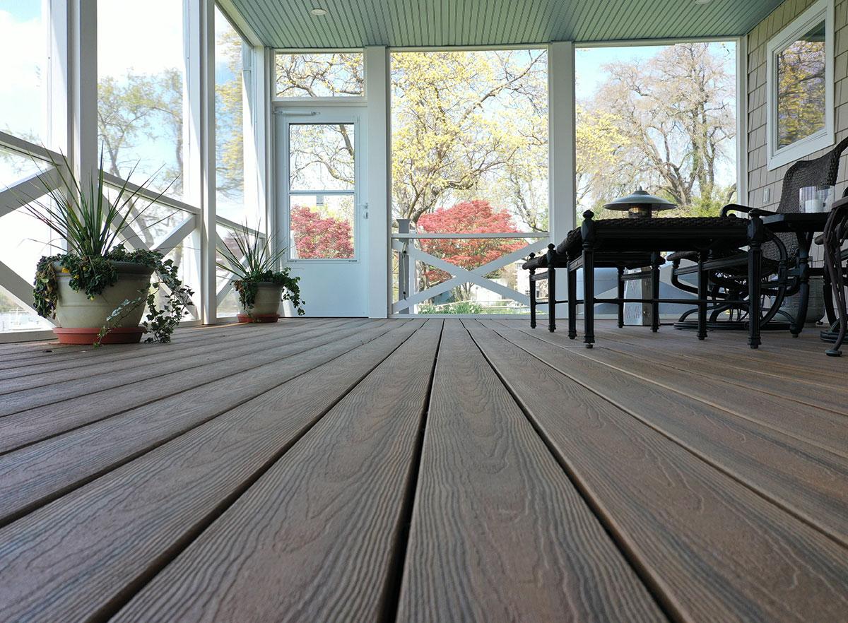 Covered porch featuring our Optima Dekk composite decking.