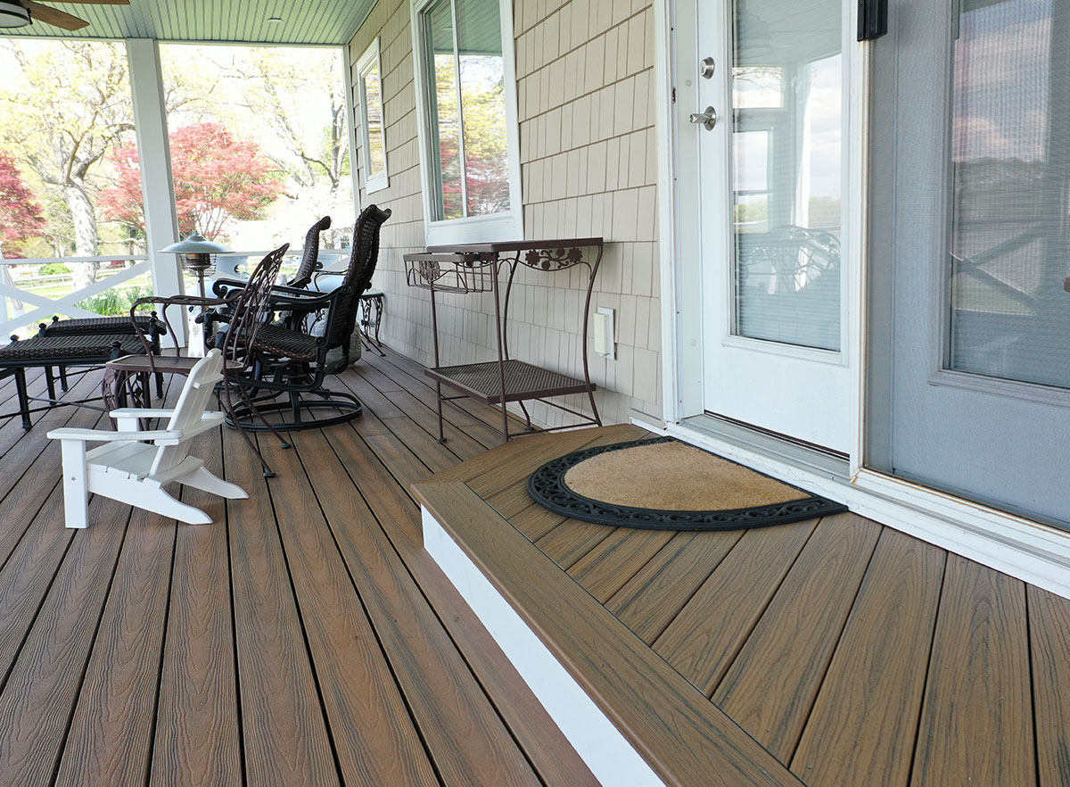 Covered porch and entry to residence showing our Optima Dekk composite decking.
