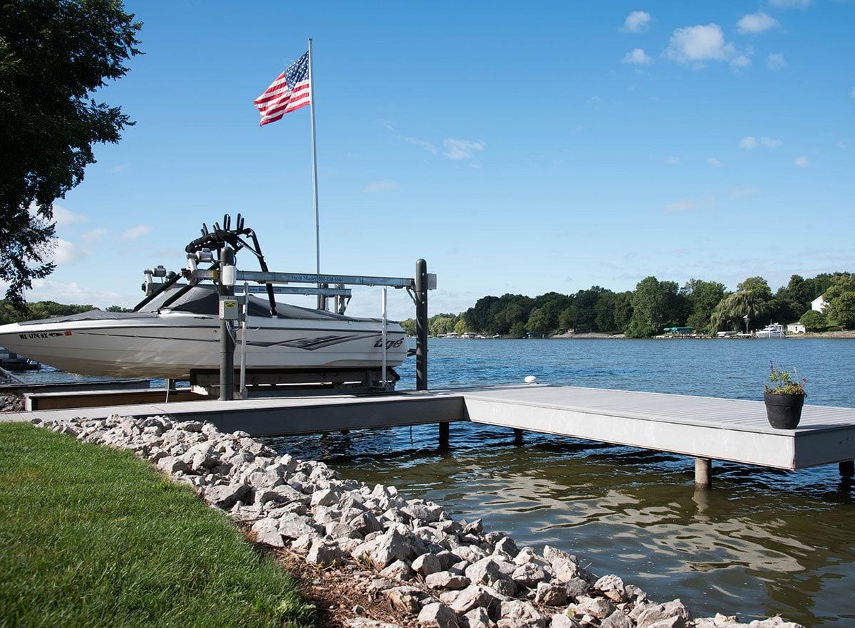 Image of a dock with speedboat showing dock built with I.Dekk HD from Duxxbak Composite Decking.